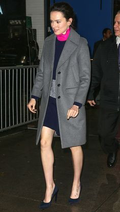 DAISY RIDLEY in Tory Burch coat, worn over a colorblock Roksanda dress