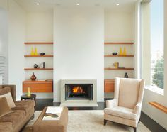 Just another floating shelve and cabinetry below beside the fireplace