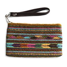 @WorldCrafts {Zapotec Wristlet ~ Zapotec Ancestory ~ Mexico} This functional and fashionable wristlet is woven of hand-dyed, hand- spun wool in a traditional Mexican pattern. Artisans at Zapotec Ancestory are delighted to preserve this beautiful ancient tradition while providing a sustainable living income for their families with dignity and hope. Measures 9-by-0.5-by-5 inches and features a brown leather strap. #fairtrade