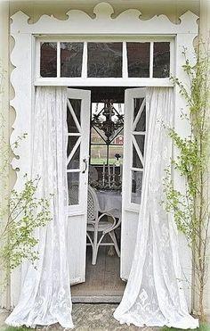Cottage Chic- love the trim around the door