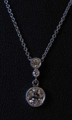 three stone pendant from GoodSoul on pricescope.