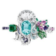 A splendid Paraiba tourmaline shines out from the Nymphs Bath bracelet ensconced below an ornamental shell detail as found in the gardens of Versailles and waves of diamond water running down its sides.