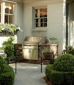 I like this better than a total built in outdoor kitchen that will need to be redone in a few years.Outdoor grill surrounded by stone. Love this outdoor space, as well as the painted brick exterior. Outdoor Rooms, Outdoor Gardens, Outdoor Living, Outdoor Decor, Outdoor Kitchens, Built In Grill, Porches, Atlanta Homes, Outside Living
