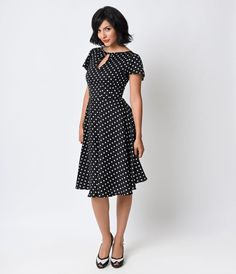 Welcome to the Formosa, darlings. The Formosa dress is a pine-worthy 1940s inspired swing in a breezy black and ivory dotted fabrication, fabulously fresh from Unique Vintage! A feminine frock boasting a self tie keyhole neckline met with fluttery cap sle