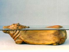 These one-of-a-kind 'water tables' created by artist and designer Derek Pearce are stunning. Carved from wood and designed to create the illusion of surface water, or a body of water, the coffee table includes animals that inhabit it like hippopotamuses, Unique Furniture, Furniture Design, Theme Nature, Water Tables, Glass Tables, Like Animals, Water Animals, Coffee Table Design, Clever Design