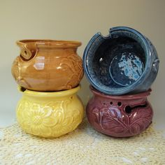 A great gift for the knitter or crocheter in your life (or maybe a great gift for yourself!), yarn bowls hold the yarn so that it doesn't roll around on the floor while you're trying to work on your project.