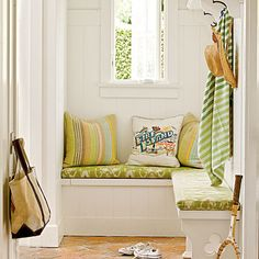 A mudroom with benches and hooks make for the ideal spot for throwing (or hanging) beach towels and hats after a day on the sand.