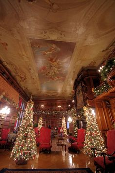 Biltmore House Library with elaborate Christmas decorations and trees - in Asheville NC.