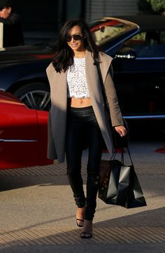Glee star Naya Rivera juxtaposes a sophisticated heavy coat with a dainty lace crop top