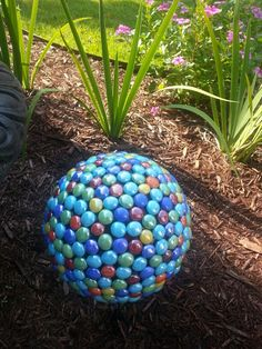 Another bowling ball turned yard art! Silicone and glass marbles. So easy!