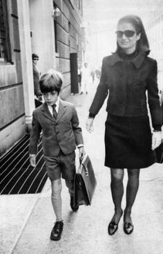 JFK Jr, 1968 walking to school (St. David's where my brothers went!) with his mother. I think we all know who she is. They were a familiar site growing up here in the Big Apple. He was just one of us NYC kids, with a famous last name and Secret Service detail, and Hollywood looks, but nonetheless - one of us who grew up in Manhattan.