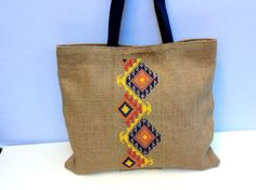 Tribal burlap tote bag cross stitched with tribal pattern by