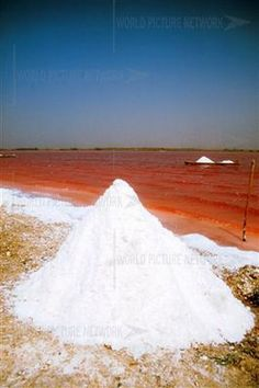 Lake Retba or Lac Rose lies north of the Cap Vert peninsula of Senegal, north east of Dakar.  It is so named for its pink waters, caused by Dunaliella salina in the water. The color is particularly visible during the dry season. The lake is also known for its high salt content, which, like that of the Dead Sea, allows people to float easily. The lake also has a small salt collecting industry and is often the finishing point of the Dakar Rally.