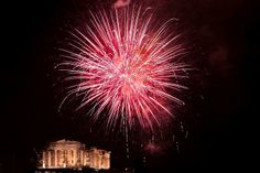 2014 New Year fireworks explode over the ancient Parthenon temple atop the Acropolis Hill in Athens, on January 1, 2014