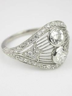 A beautiful Vintage 2 Stone Diamond Ring with Old European Cut Diamonds, handcrafted in Platinum  #VintageRing #Platinum #OldEuropeanCutDiamonds