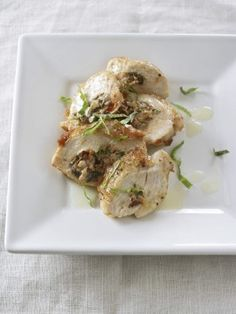 Stuff chicken breasts with goat cheese, basil and sun-dried tomatoes, then drizzle with lemon butter for a hearty main.
