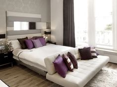 I love the idea of a simple couch at the end of our bed in the master upstairs.