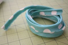 DIY piping....need to see if we have a zipper foot in the box of accessories for the sewing machine. I so want to make some.