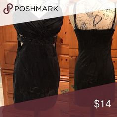 Black sequin dress with side cutouts This dress is absolutely perfect for a night out! The side sexy cutouts in addition having small sequins throughout. There's a zipper in the back and two adjustable shoulder straps. The back measures 23 inches in length and about 27 inches from top of chest (beginning of strap) in the front. Final picture showing pilling that are hardly noticeable due to color and if this is worn for the clubs! Price reflects condition. Charlotte Russe Dresses Mini