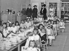 Dr. Montessori {standing second from the left hand side} visiting a Montessori school in San Francisco.