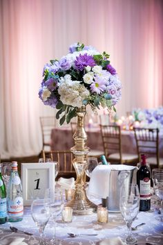 Lavender and whites inspired centrepieces. Perfect for your luxury wedding or event.
