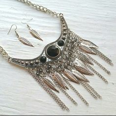 🎉REDUCED🎉 Silver Necklace Set Silver Fashion Statement Necklace accented with dangling silver feathers and dotted with black beads. Matching Feather Earrings included. Jewelry