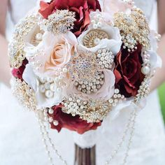 Gorgeous brooch bouquet in pink and burgundy.