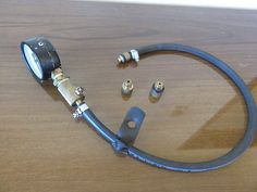 Compression Tester by Cascao -- Had made years ago an engine compression tester. Material: 0-300psi manometer High pressure hose 2 hose clamps Few brass parts made on lathe 2 tyre sharader valves (one for reading release anothes as one way valve) More...