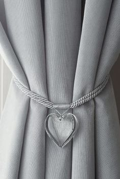 Who knew a tie back could be so gorgeous? This heart shaped one is perfect for a modern home!
