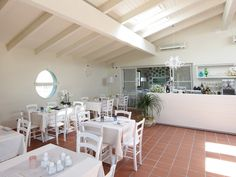 Contemporary Restaurants Interior Italian Design- all white tables/chairs
