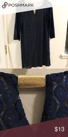 Navy dress Excellent condition. No stains or tears. Has a nude slip attached underneath and a lace over it. Gold piece at the top. Dresses