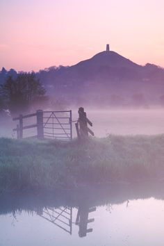 """Glastonbury Tor viewed through the mists of Avalon (insulam Auallonis). If you listen carefully you might just be able to hear strains of Carl Orff's """"O Fortuna"""" drifting like the mist across the fields - perhaps heralding the late king's long foretold return to Albion? (just click on the image to get the full effect!)"""