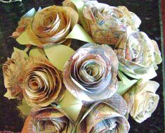 such a cool idea for a bride:   The Stephanie vintage map Spiral rose  paper by HBixbyArtworks, $48.00