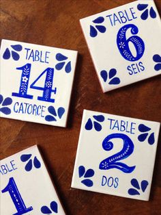 DIY Spanish tile table numbers for our wedding   Tiles ordered from Tierra Y Fuego. Painted with acrylic and design etched with cheap calligraphy pen nib. Spray with fixative to prevent scratching.