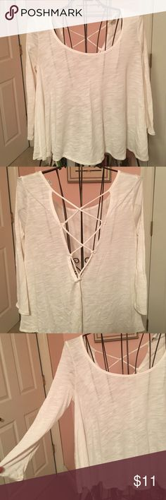 American Eagle Open Back Top Cute 3-quarter sleeve shirt! From American Eagle Outfitters! Cute open back! Tight fit in the arms loose at the bottom! No trades! Open to offers! American Eagle Outfitters Tops Tees - Long Sleeve