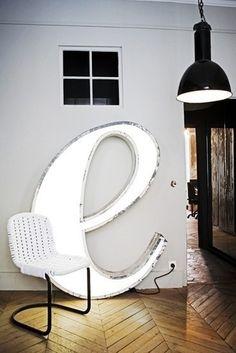 herringbone floor + lit letter e + light fixture