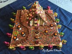 For our Easter table center piece, Michael and I made this Swiss Chalet Chocolate House. We made it from milk chocolate, which we tempered, and multicoloured mini Easter … Chocolate House, Swiss Chalet, Easter Table, Table Centerpieces, Gingerbread, Baking, Desserts, Food, Tailgate Desserts