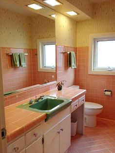 Bradbury Atomic Age Wallpaper Makes These Two 1950s Pink Bathrooms Even  More Luscious
