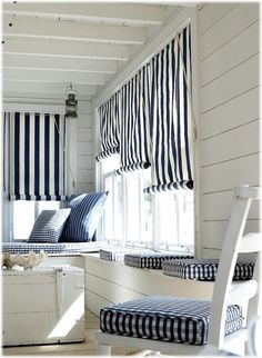 Lovely fresh coastal room with bold stripes and checks keeping the vibe contemporary.
