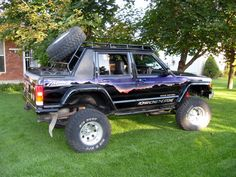 "It is a 1999 Jeep Cherokee with an 8"" suspension lift, 33"" tires  and a custom chop that removed the back cargo area and  added a trunk"