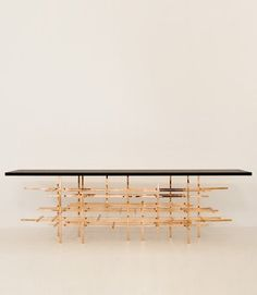 Modern console table designed by Fran Taubman for Ralph Pucci - made from copper tubes and marble top.  Find more Modern Console Table Inspirations on www.modernconsoletables.net