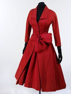 Christian Dior, 1955. Dior often named his collections after letters of the alphabet, and this particular dress comes from the 'Y line'. The deep v-neck of this dress typifies Dior's 'Y' motif, as does the inverted Y shape of the pleats of the skirt.