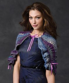This clever crochet design uses ribbon drawstrings to gather up the back and edges. This gives it a feminine ruffled look without having to crochet the ruffles!