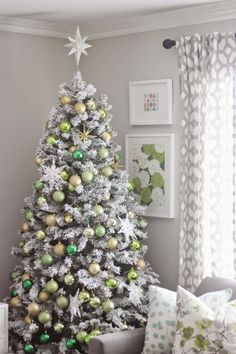The Frosty Flocked Christmas tree decorated with shades of chartreuse and green bulb. Decorated by @mrschic