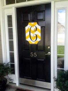 yellow chevron initial plaque.  I would change the yellow to a blue :)