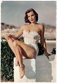 1950s beach babe in a polkadot cozzie