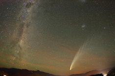 Comet McNaught photographed in Feb. 2007, between Mt Remarkable and Cecil Peak, Queenstown, S.I. New Zealand.  Image shows the Milky way on the left, comet on the right and a meteor streak to the left of the comet.