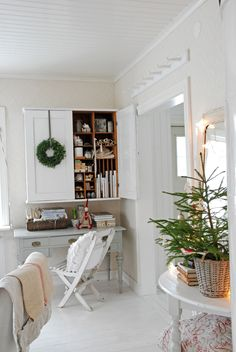 Lovely desk moment: simple wreath and tree in small basket