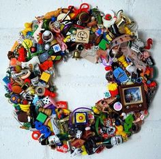 DIY : Toy Wreath - Totally cute idea to do something with all those small sentimental toys that the kids (okay or you) don't want to get rid of but are never played with anymore. This way they still have them and the toys are hanging on the wall - out of the way.