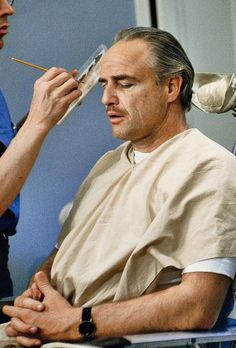 """Marlon Brando in the makeup chair while preparing for his role as Don Vito Corleone for """"The Godfather"""" circa Marlon Brando The Godfather, Godfather Movie, Hollywood Actor, Hollywood Celebrities, Hollywood Stars, Hollywood Actresses, Classic Hollywood, American Crime, American Actors"""